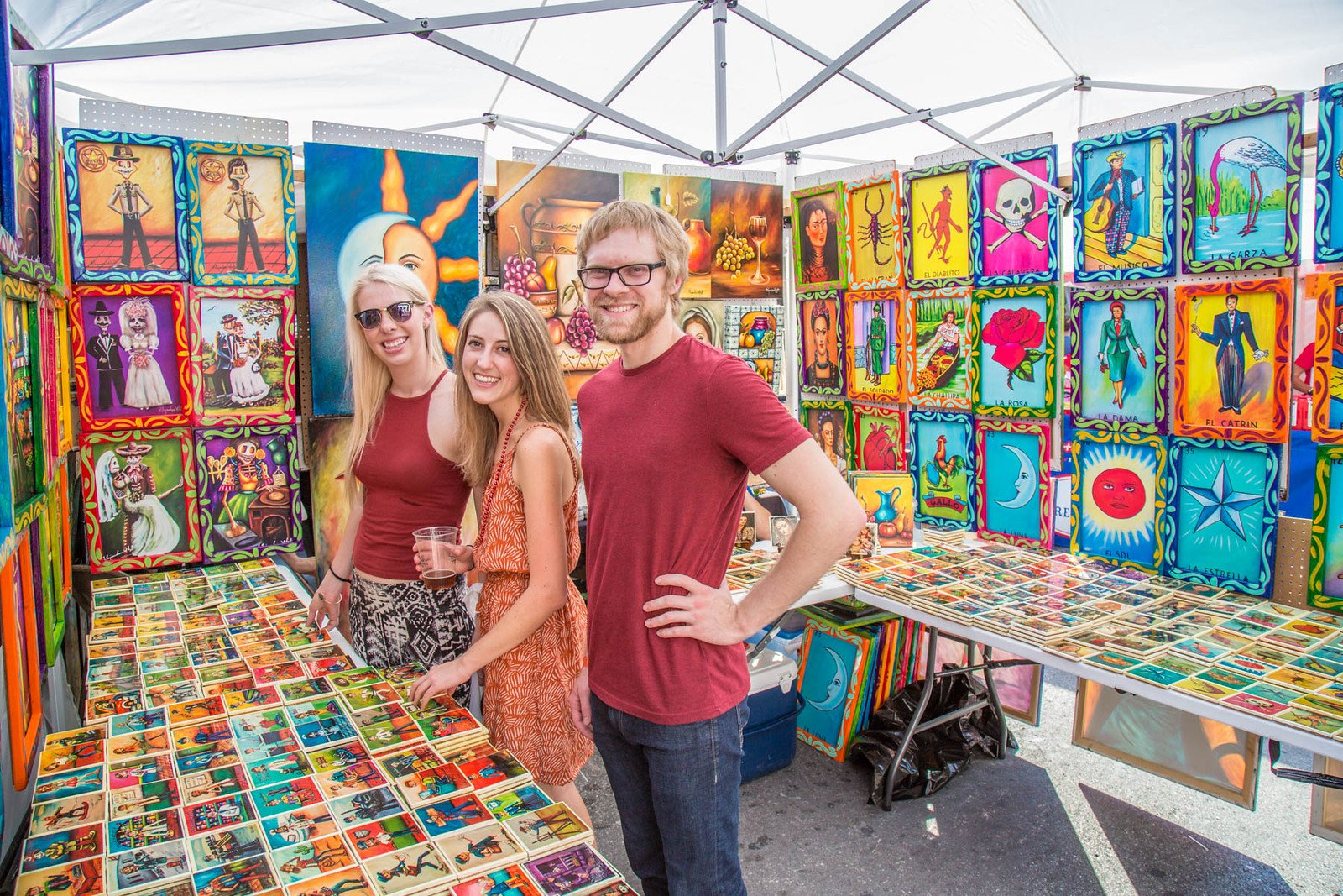 Artist's booths and vendors line the street at Austin's Pecan Street Festival.